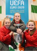 28 November 2018; Former Republic of Ireland midfielder Keith Andrews, Jessica Ziu of Republic of Ireland and Shelbourne, and Lord Mayor of Dublin Nial Ring brought the the iconic Henri Delaunay trophy to visit St Joseph's Co-Education Primary School, East Wall, to mark Dublin's hosting of the UEFA EURO 2020 Qualifying Group Draw at the Convention Centre on Sunday, December 2nd. To celebrate the Qualifying Draw, Dublin City Council and the FAI will hold three 'Street Legends' community football events at Aughrim St Community Hall (Wednesday, November 28th), Mountjoy Square South (Thursday, November 29th) and Commons Street (Saturday, December 1st). The hosting of the Qualifying Draw will also coincide with the launch of the National Football Exhibition at the Printworks, Dublin Castle, which will open to the public on Sunday, December 2nd 2018. The Exhibition will be home to a number of elements with historical significance to Irish football. Four tournament games will be hosted at Dublin's Aviva Stadium during UEFA EURO 2020, the largest sporting event to ever be hosted in the country. Pictured with the Henri Delaunay trophy are pupils of St Joseph's Co-Education Primary School, East Wall, from left, Amber McCarthy, Sophie Duffy and Courtney Kenny. Photo by Stephen McCarthy/Sportsfile