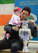 28 November 2018; Former Republic of Ireland midfielder Keith Andrews, Jessica Ziu of Republic of Ireland and Shelbourne, and Lord Mayor of Dublin Nial Ring brought the the iconic Henri Delaunay trophy to visit St Joseph's Co-Education Primary School, East Wall, to mark Dublin's hosting of the UEFA EURO 2020 Qualifying Group Draw at the Convention Centre on Sunday, December 2nd. To celebrate the Qualifying Draw, Dublin City Council and the FAI will hold three 'Street Legends' community football events at Aughrim St Community Hall (Wednesday, November 28th), Mountjoy Square South (Thursday, November 29th) and Commons Street (Saturday, December 1st). The hosting of the Qualifying Draw will also coincide with the launch of the National Football Exhibition at the Printworks, Dublin Castle, which will open to the public on Sunday, December 2nd 2018. The Exhibition will be home to a number of elements with historical significance to Irish football. Four tournament games will be hosted at Dublin's Aviva Stadium during UEFA EURO 2020, the largest sporting event to ever be hosted in the country. Pictured with the Henri Delaunay trophy is Former Republic of Ireland midfielder Keith Andrewws and 7-month-old Isla Mairead Lynch, from East Wall. Photo by Stephen McCarthy/Sportsfile
