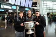 29 November 2018; Dublin players, from left, Con O'Callaghan, James McCarthy and Brian Howard with the Sam Maguire Cup at Dublin Airport prior to their departure to the PwC All Stars tour in Philadelphia, USA. Photo by David Fitzgerald/Sportsfile