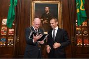 30 November 2018; Lord Mayor of Dublin Nial Ring, left, with a UEFA pennant, and UEFA President Aleksander Ceferin,  at a EURO88 Republic of Ireland squad reception at the Mansion House in Dublin. Photo by Stephen McCarthy/Sportsfile