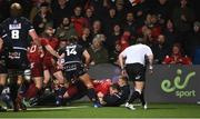 30 November 2018; Chris Farrell of Munster scores his side's first try despite the efforts of Dougie Fife of Edinburgh during the Guinness PRO14 Round 10 match between Munster and Edinburgh at Irish Independent Park in Cork. Photo by Diarmuid Greene/Sportsfile