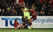 30 November 2018; Chris Farrell of Munster is congratulated by team-mate Conor Murray after scoring his side's last try of the game despite the efforts of Senitiki Nayalo of Edinburgh during the Guinness PRO14 Round 10 match between Munster and Edinbugh at Irish Independent Park in Cork. Photo by Diarmuid Greene/Sportsfile