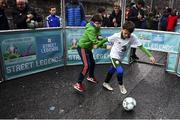 1 December 2018; Hugh Moore, age 9, left, and Josh Gafney, age 9, from Donabate during a skills game as Portuguese footballing legends Luis Figo, Nuno Gomes and Vítor Baía were in Dublin to showcase their skills at the Street Legends Community Football Event on Commons Street. The Street Football Community Football event is a joint initiative by Dublin City Council and the Football Association of Ireland ahead of the UEFA EURO 2020 Qualifying Draw in the Convention Centre on Sunday, 2nd December. The Street Legends Community Football Events kicked off on Wednesday, November 28. Other key activations include: Street Legends Community Football, Saturday, December 1, 3pm to 6pm, Commons Street, Dublin 1 with Portuguese legends Nuno Gomes and Vítor Baía. National Football Exhibition, Sunday, December 2 to Sunday, December 9, 11am-7pm, The Printworks, Dublin Castle Both events are free to attend and open to all ages and abilities. Photo by Sam Barnes/Sportsfile