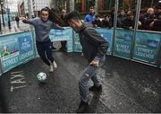1 December 2018; Republic of Ireland international Niamh Farrelly, left, and Shane Boyle, from Sheriff Street in Dublin during a skills game as Portuguese footballing legends Luis Figo, Nuno Gomes and Vítor Baía were in Dublin to showcase their skills at the Street Legends Community Football Event on Commons Street. The Street Football Community Football event is a joint initiative by Dublin City Council and the Football Association of Ireland ahead of the UEFA EURO 2020 Qualifying Draw in the Convention Centre on Sunday, 2nd December. The Street Legends Community Football Events kicked off on Wednesday, November 28. Other key activations include: Street Legends Community Football, Saturday, December 1, 3pm to 6pm, Commons Street, Dublin 1 with Portuguese legends Nuno Gomes and Vítor Baía. National Football Exhibition, Sunday, December 2 to Sunday, December 9, 11am-7pm, The Printworks, Dublin Castle Both events are free to attend and open to all ages and abilities. Photo by Sam Barnes/Sportsfile