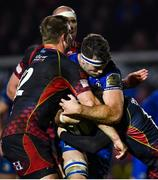 1 December 2018; Caelan Doris of Leinster is tackled by Hallam Amos, left, and Jordan Williams of Dragons during the Guinness PRO14 Round 10 match between Dragons and Leinster at Rodney Parade in Newport, Wales. Photo by Ramsey Cardy/Sportsfile
