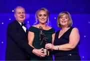 1 December 2018; Neamh Woods of Tyrone is presented with the TG4 Intermediate Players' Player of the Year Award by Ard Stiúrthóir TG4 Alan Esslemont and President of LGFA Marie Hickey during the TG4 Ladies Football All Stars Awards 2018, in association with Lidl, at the Citywest Hotel in Dublin. Photo by Brendan Moran/Sportsfile