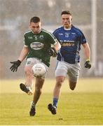 2 December 2018; Niall Friel of Gaoth Dobhair in action against Shane Carey of Scotstown during the AIB Ulster GAA Football Senior Club Championship Final match between Gaoth Dobhair and Scotstown at Healy Park in Tyrone. Photo by Oliver McVeigh/Sportsfile