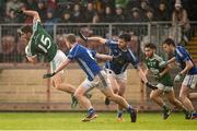2 December 2018; Michael Carroll of Gaoth Dobhair in action against Ross McKenna and Donal Morgan of Scotstown  during the AIB Ulster GAA Football Senior Club Championship Final match between Gaoth Dobhair and Scotstown at Healy Park in Tyrone. Photo by Oliver McVeigh/Sportsfile