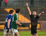 2 December 2018; Referee Noel Mooney issues a red card to Eamonn McGee of Gaoth Dobhair, centre, late on during the AIB Ulster GAA Football Senior Club Championship Final match between Gaoth Dobhair and Scotstown at Healy Park in Tyrone. Photo by Oliver McVeigh/Sportsfile