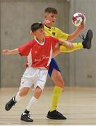 4 December 2018; Ronan Clarke of St. Louis Community School, Kiltimagh, Mayo, in action against Conor McGinty of St. Columba's College, Stranorlar, Donegal, during the Post-Primary Schools National Futsal Finals match between St. Louis Community School, Kiltimagh, Mayo and St. Columba's College, Stranorlar, Donegal at Waterford IT Sports Arena in Waterford. Photo by Eóin Noonan/Sportsfile