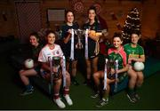 4 December 2018; In attendance, from left, Nicole Rooney of Emmet Óg and Sarah Murphy of Clontarf with the Ladies All-Ireland Intermediate Club Trophy, Amy Ring, captain of Foxrock-Cabinteely and Eimear Meaney of Mourneabbey with the Dolores Tyrrell Memorial Cup and Amy Turpin of Glanmire and Shauna Henry of Tourlestrane with the Ladies All-Ireland Junior Club Championship Perpetual Cup during the 2018 All-Ireland Ladies Club Football Finals Captains Day at Croke Park in Dublin. Photo by David Fitzgerald/Sportsfile