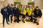 4 December 2018; St. Louis Community School, Kiltimagh, Mayo captain Sean O'Neill being presented with the cup by FAI President Donal Conway after the Post-Primary Schools National Futsal Finals at Waterford IT Sports Arena in Waterford. Photo by Eóin Noonan/Sportsfile