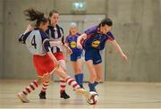 4 December 2018; Kate Carr of Ursuline secondary school, Thurles, Tipperary in action against Sophie O'Hagan of Coláiste Chiaráin, Leixlip, Kildare during the Post-Primary Schools National Futsal Finals match between Ursuline secondary school, Thurles, Tipperary and Coláiste Chiaráin, Leixlip, Kildare at Waterford IT Sports Arena in Waterford. Photo by Eóin Noonan/Sportsfile