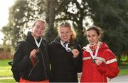 8 December 2018; Atheltes from left, Rachel Glennon of Mullingar Harriers, Westmeath, Kate Veale of West Waterford A.C. and Veronica Burke of Ballinasloe & District A.C., Galway, with their medals for the women's 20k event after the Irish Life Health National Race Walking Championships 2018 at St. Anne's Park in Dublin. Photo by Eóin Noonan/Sportsfile