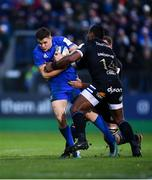 8 December 2018; Garry Ringrose of Leinster is tackled by Sam Underhill, left, and Semesa Rokoduguni of Bath during the European Rugby Champions Cup Pool 1 Round 3 match between Bath and Leinster at the Recreation Ground in Bath, England. Photo by Ramsey Cardy/Sportsfile