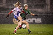 8 December 2018; Siobhán Killeen of Clontarf shoots to score her side's third goal despite the attention of Áine McQuaid of Emmet Óg during the All-Ireland Ladies Football Intermediate Club Championship Final match between Clontarf GAA and Emmet Óg at Parnell Park in Dublin. Photo by Stephen McCarthy/Sportsfile
