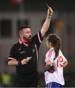 8 December 2018; Referee Seamus Mulvihill issues a yellow card to Kate Fitzgibbon of Clontarf during the All-Ireland Ladies Football Intermediate Club Championship Final match between Clontarf GAA, Dublin, and Emmet Óg, Monaghan, at Parnell Park in Dublin. Photo by Stephen McCarthy/Sportsfile