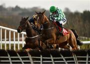 9 December 2018; Tornado Flyer, right, with Ruby Walsh up, jumps the last alongside eventual second place Take Revenge, left, with Donal McInerney up, on their way to winning the Punchestown Racecourse Of The Year Maiden Hurdle at Punchestown Racecourse in Naas, Co. Kildare. Photo by Seb Daly/Sportsfile