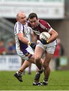 9 December 2018; David McGivney of Mullinalaghta St Columba's in action against Pat Burke of Kilmacud Crokes during the AIB Leinster GAA Football Senior Club Championship Final match between Kilmacud Crokes and Mullinalaghta St Columba's at Bord na Móna O'Connor Park in Offaly. Photo by Daire Brennan/Sportsfile