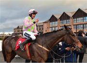 9 December 2018; Jockey Ruby Walsh acknowledges the crowd as he enters the winners enclosure after winning the John Durkan Memorial Punchestown Steeplechase on Min at Punchestown Racecourse in Naas, Co. Kildare. Photo by Seb Daly/Sportsfile