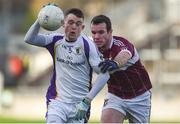 9 December 2018; Cian O'Connor of Kilmacud Crokes in action against David McGivney of Mullinalaghta St Columba's during the AIB Leinster GAA Football Senior Club Championship Final match between Kilmacud Crokes and Mullinalaghta St Columba's at Bord na Móna O'Connor Park in Offaly. Photo by Daire Brennan/Sportsfile