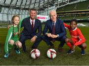 11 December 2018; SPAR, Ireland's leading convenience retail group, and the Football Association of Ireland today announced a sponsorship agreement which will see SPAR renew as the Official Convenience Store of the FAI. The announcement took place at the Aviva Stadium with the Republic of Ireland's new manager Mick McCarthy along with head coach of the Republic of Ireland Women's International Senior Team, Colin Bell in attendance. The partnership between SPAR and the FAI began in 2015 encompassing the Irish national football team and the hugely successful SPAR FAI Primary School 5s Programme. Pictured are, from left, Éabha Seery, age 12, from Clondalkin, Colin Bell, Republic of Ireland Women's National Team manager, Mick McCarthy, Republic of Ireland manager, and Murphy Alade, age 11, from Irishtown, during the 2018 SPAR and FAI Sponsorship Renewal at the Aviva Stadium in Dublin. Photo by Seb Daly/Sportsfile