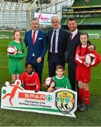 11 December 2018; SPAR, Ireland's leading convenience retail group, and the Football Association of Ireland today announced a sponsorship agreement which will see SPAR renew as the Official Convenience Store of the FAI. The announcement took place at the Aviva Stadium with the Republic of Ireland's new manager Mick McCarthy along with head coach of the Republic of Ireland Women's International Senior Team, Colin Bell in attendance. The partnership between SPAR and the FAI began in 2015 encompassing the Irish national football team and the hugely successful SPAR FAI Primary School 5s Programme. Pictured are, from left, Éabha Seery, age 12, from Clondalkin, SPAR Sales Director Colin Donnelly, Mick McCarthy, Republic of Ireland manager, Colin Bell, Republic of Ireland Women's National Team manager, Alex Carrick, age 12, from Clondalkin, Murphy Alade, age 11, from Irishtown, and Cameron Tormey, age 11, from Lucan, during the 2018 SPAR and FAI Sponsorship Renewal at the Aviva Stadium in Dublin. Photo by Seb Daly/Sportsfile