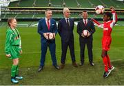 11 December 2018; SPAR, Ireland's leading convenience retail group, and the Football Association of Ireland today announced a sponsorship agreement which will see SPAR renew as the Official Convenience Store of the FAI. The announcement took place at the Aviva Stadium with the Republic of Ireland's new manager Mick McCarthy along with head coach of the Republic of Ireland Women's International Senior Team, Colin Bell in attendance. The partnership between SPAR and the FAI began in 2015 encompassing the Irish national football team and the hugely successful SPAR FAI Primary School 5s Programme. Pictured are, from left, Éabha Seery, age 12, from Clondalkin, SPAR Sales Director Colin Donnelly, Mick McCarthy, Republic of Ireland manager, Colin Bell, Republic of Ireland Women's National Team manager, and Murphy Alade, age 11, from Irishtown, during the 2018 SPAR and FAI Sponsorship Renewal at the Aviva Stadium in Dublin. Photo by Seb Daly/Sportsfile