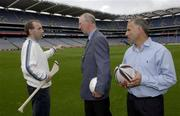 19 September 2003; DJ Carey explains the bounce of the sliothar to Jack Charlton and Tony Ward when the three legends of Irish sport came together, in Croke Park, Dublin, for a Flora pro.active cholesterol awareness campaign to mark World Heart Day, which is Sunday 28 September 2003. Picture credit; Ray McManus / SPORTSFILE *EDI*