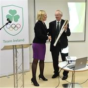 11 December 2018; Sarah Keane, President of Olympic Federation of Ireland passes hands an olympic torch to John Treacy, Chief Executive Sport Ireland as the Olympic Federation of Ireland & Sport Ireland Institute launch ground-breaking new performance support ahead of Tokyo 2020 at the Sports Ireland Institute, in Abbotstown, Dublin. Photo by Sam Barnes/Sportsfile