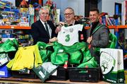 12 December 2018; FAI CEO John Delaney, left, along with Republic of Ireland Women's National Team manager Colin Bell, right, were on hand today to hand over Ireland bags filled with jerseys, footballs, scarfs & other merchandise to Liam Casey, centre, East Region President, St Vincent De Paul, at the St Vincent De Paul depot on Sean McDermott Street, Dublin. The gifts are part of an annual Christmas donation for families in need. Photo by Seb Daly/Sportsfile
