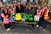 12 December 2018; FAI CEO John Delaney along with Republic of Ireland Women's National Team manager Colin Bell were on hand today to hand over Ireland bags filled with jerseys, footballs, scarfs & other merchandise to Liam Casey, East Region President, St Vincent De Paul, at the St Vincent De Paul depot on Sean McDermott Street, Dublin. The gifts are part of an annual Christmas donation for families in need. Pictured are FAI CEO John Delaney, Republic of Ireland Women's National Team manager Colin Bell, and Liam Casey, East Region President, St Vincent De Paul, with volunteers and helpers, at the St Vincent De Paul depot on Sean McDermott Street, Dublin. Photo by Seb Daly/Sportsfile