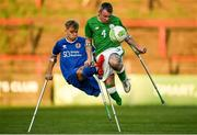 4 May 2018; Garry Hoey of Ireland in action against Jamie Tregaksiss of England during the Citywest Hotel EAFF Amputee Football Weeks Tournament match between Ireland and England at Dalymount Park in Dublin. Photo by Harry Murphy/Sportsfile