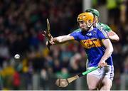 14 December 2018; Jake Morris of Tipperary in action against Sean Finn of Limerick during the Co-Op Superstores Munster Hurling League 2019 match between Limerick and Tipperary at the Gaelic Grounds in Limerick. Photo by Matt Browne/Sportsfile