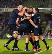 15 December 2018; Rory O'Loughlin of Leinster celebrates with Devin Toner, left,  Adam Byrne, right, and Luke McGrath, far right, after scoring his side's second try during the Heineken Champions Cup Pool 1 Round 4 match between Leinster and Bath at the Aviva Stadium in Dublin. Photo by Ramsey Cardy/Sportsfile