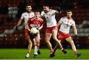 20 December 2018; Jason Rocks of Derry in action against Kyle Coney of Tyrone during the Bank of Ireland Dr. McKenna Cup Round 1 match between Derry and Tyrone at Celtic Park, Derry. Photo by Oliver McVeigh/Sportsfile