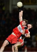 20 December 2018; Emmet Bradley of Derry in action against Brian Kennedy of Tyrone during the Bank of Ireland Dr. McKenna Cup Round 1 match between Derry and Tyrone at Celtic Park, Derry. Photo by Oliver McVeigh/Sportsfile