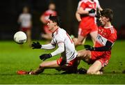 20 December 2018; Darragh Canavan of Tyrone in action against Paul McNeill of Derry during the Bank of Ireland Dr. McKenna Cup Round 1 match between Derry and Tyrone at Celtic Park, Derry. Photo by Oliver McVeigh/Sportsfile