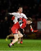 20 December 2018; Darragh Canavan of Tyrone kicks to score his first ever point despite the attention of Paul McNeill of Derry during the Bank of Ireland Dr. McKenna Cup Round 1 match between Derry and Tyrone at Celtic Park, Derry. Photo by Oliver McVeigh/Sportsfile