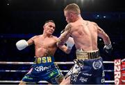22 December 2018; Josh Warrington, left, in action against Carl Frampton during their IBF World Featherweight title bout at the Manchester Arena in Manchester, England. Photo by David Fitzgerald/Sportsfile