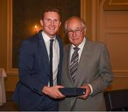 22 December 2018; Ciarán Kilkenny of Dublin presents a medal toTony Gillen, a member of the 1958 All Ireland winning Dublin team, who were guests of honour at presentation of the 2108 GAA Football All-Ireland Senior Championship medals at the InterContinental Dublin, Simmonscourt Road, Ballsbridge, Dublin Photo by Ray McManus/Sportsfile