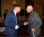 22 December 2018; Philly McMahon of Dublin presents a medal to Jim Crowley, a member of the 1958 All Ireland winning Dublin team, who were guests of honour at presentation of the 2108 GAA Football All-Ireland Senior Championship medals at the InterContinental Dublin, Simmonscourt Road, Ballsbridge, Dublin Photo by Ray McManus/Sportsfile