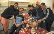 25 December 2018; Michael Darragh Macauley, Jack McCaffrey, Bernard Brogan, captain Stephen Cluxton, and Michael Fitzsimons with seven year old Cormac Byrne, from Mullingar, Co Westmeath, and the Sam Maguire Cup during the Dublin Football team visit to the Children's University Hospital, Temple Street in Dublin. Photo by Ray McManus/Sportsfile