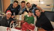 25 December 2018; Captain Stephen Cluxton, Bernard Brogan, Michael Fitzsimons, Jack McCaffrey and Michael Darragh Macauley, with eight year old Ross Duffy, from Coolock, Dublin, and the Sam Maguire Cup during the Dublin Football team visit to the Children's University Hospital, Temple Street in Dublin. Photo by Ray McManus/Sportsfile