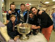 25 December 2018; Jack McCaffrey, Michael Fitzsimons, captain Stephen Cluxton, Bernard Brogan, Michael Darragh Macauley with Séamus Byrne, age 11, from Cabra, Dublin, and the Sam Maguire Cup during the Dublin Football team visit to the Children's University Hospital, Temple Street in Dublin. Photo by Ray McManus/Sportsfile