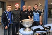 25 December 2018;  Eoin Murchan, captain Stephen Cluxton, and Jack McCaffrey, Dublin Fire Brigade paramedics Ciaran Maplin and Aidan Leavy, from Kilbarrack Fire Station, and the Sam Maguire Cup during the Dublin Football team visit to Beaumont Hospital in Dublin.  Photo by Ray McManus/Sportsfile