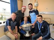 25 December 2018; Manager Jim Gavin, captain Stephen Cluxton, Jack McCaffrey, Eoin Murchan, patient Laurence Shannon, from Portmarnock, and  the Sam Maguire Cup during the Dublin Football team visit to Beaumont Hospital in Dublin.  Photo by Ray McManus/Sportsfile