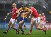 29 December 2018; Cathal Malone of Clare in action against Aidan Walsh, right, and Michael O'Halloran of Cork during the Co-Op Superstores Munster Hurling League 2019 match between Clare and Cork at Cusack Park in Clare. Photo by Harry Murphy/Sportsfile