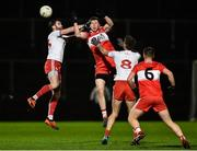 20 December 2018; Ronan McNamee of Tyrone in action against Emmet Bradley of Derry  during the Bank of Ireland Dr. McKenna Cup Round 1 match between Derry and Tyrone at Celtic Park, Derry. Photo by Oliver McVeigh/Sportsfile
