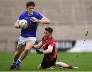 30 December 2018; Mark Stuart of Cavan in action against Conor Francis of Down during the Bank of Ireland Dr McKenna Cup Round 1 match between Cavan and Down at Kingspan Breffni Park in Cavan. Photo by Harry Murphy/Sportsfile